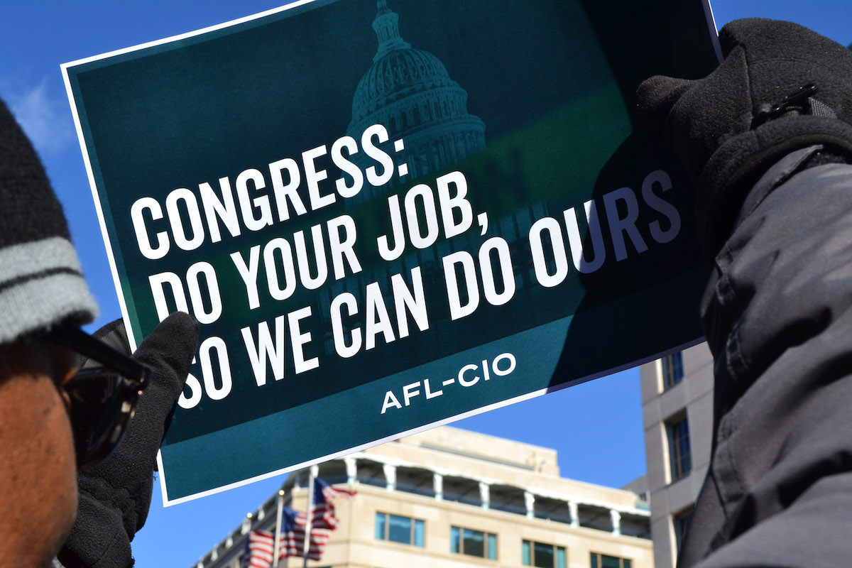 Sign calling for Congress to do its job, from rally to end the January 2019 government shutdown.