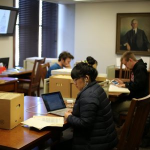 researchers in archives reading room