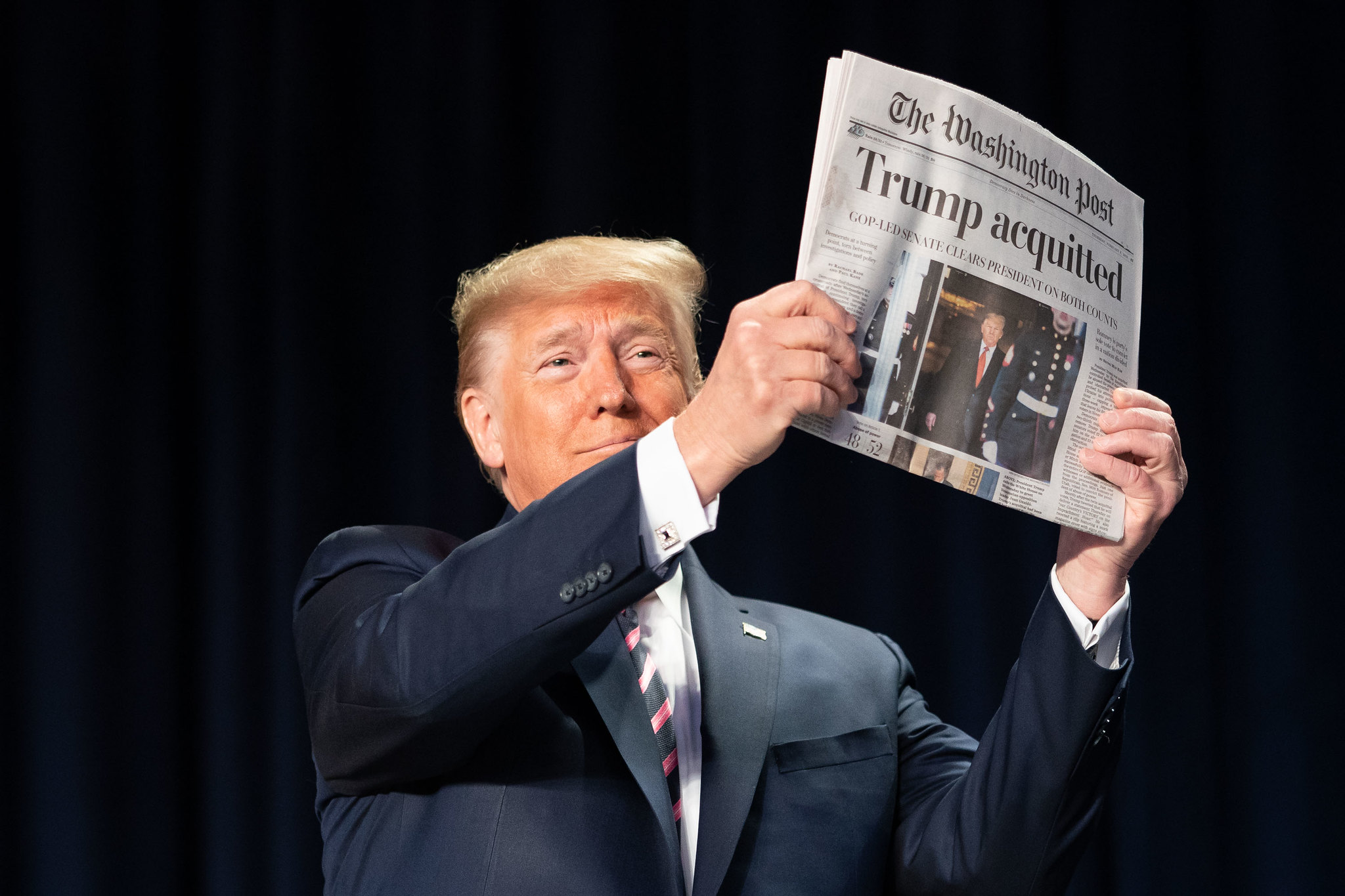 "President Trump Holding Copy of Washington Post with headline ""Trump Acquitted"""